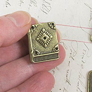 Bronze Closed Book Charm**