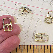 Tiny Gold Buckles*